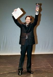 Lau Chi-lung won the Champion of Tremolo Solo at the 1st HK Harmonica Festival 2003